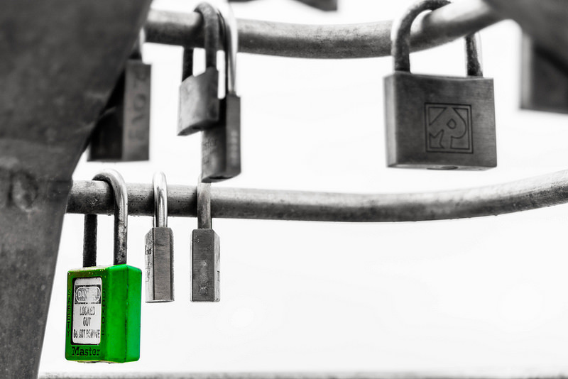 green Masterlock padlock next to other locks